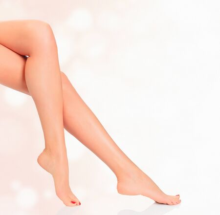 chiropody: Legs of a woman against abstract background with circles and copyspace Stock Photo