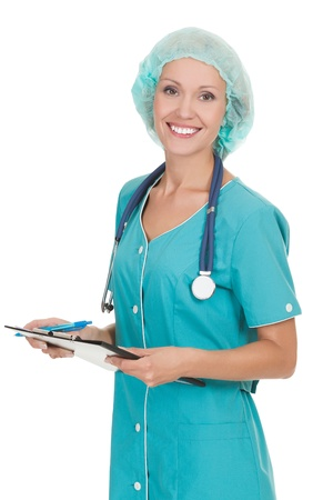 Cheerful medical doctor woman with stethoscope and clipboard. Isolated over white background Stock Photo - 15289252