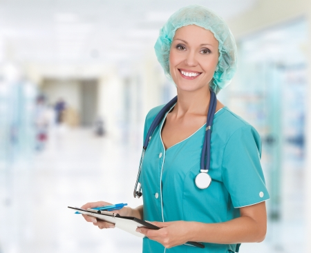 Cheerful medical doctor woman in the hospital photo