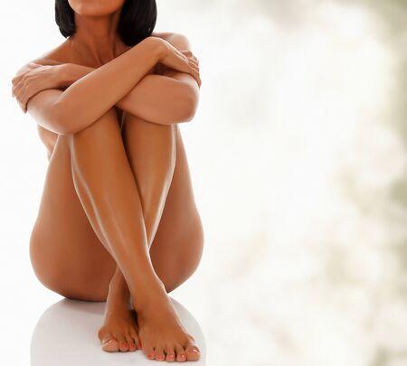 feet naked: Naked woman sitting  Stock Photo
