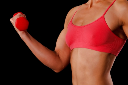 muscular woman: Fitness woman with barbells on black background