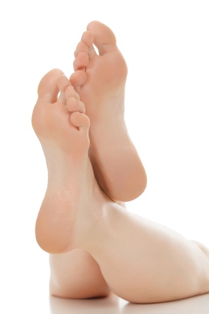 Woman feet over white  photo