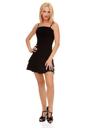 Sexy blond lady in small black dress isolated on white  Stock Photo - 15645150
