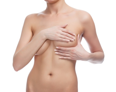 Cropped image of a female controlling breast for cancer, isolated on white background.  Stock Photo