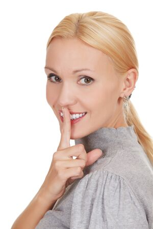 happy woman with finger on lips, isolated on white background photo