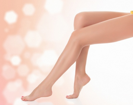 waxed: Long female legs after depilation, abstract blurred background  Stock Photo