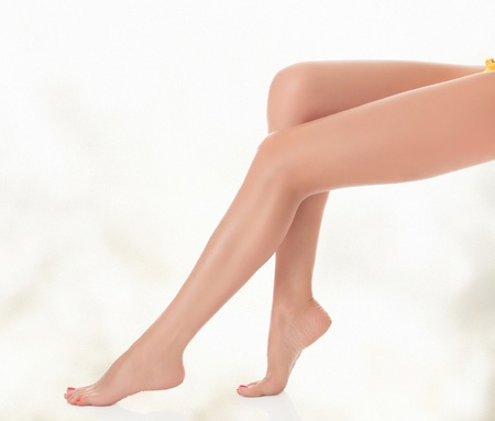 chiropody: Legs of a woman against abstract background with circles and copyspace