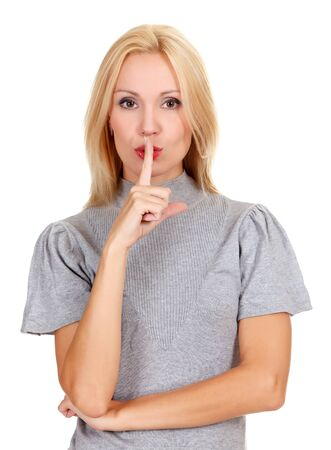 woman with finger on lips, isolated on white background photo