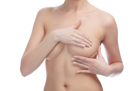 undressed: Cropped image of a female controlling breast for cancer, isolated on white background