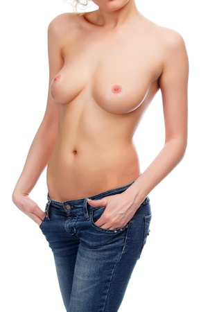 female nudity: sexy woman in blue jeans against white background