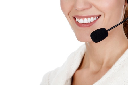 Cheerful call center operator against white background Stock Photo - 16191138