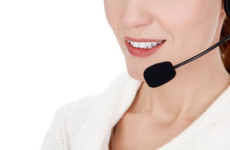 Cheerful call center operator against white background Stock Photo - 16245205