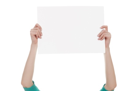 Female hands holding a blank white paper isolated over white background  photo