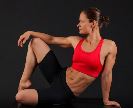 Sporty woman on black background photo
