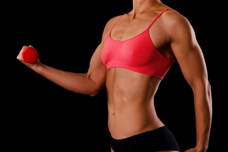 triceps: Fitness woman with barbells on black background
