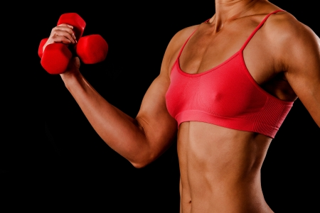 bicep: Fitness woman with barbells on black background