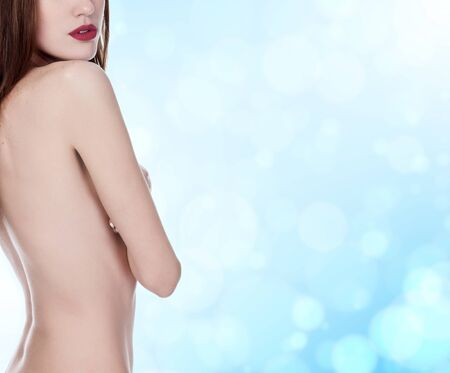 woman: beautiful woman with long hair on blue blurred background