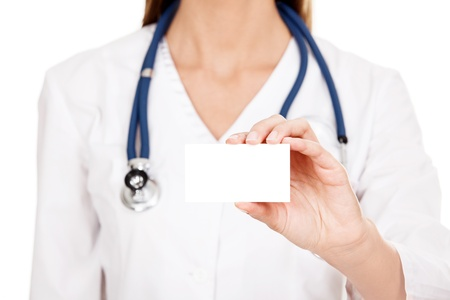 Female doctor shows empty white card, isolated on white background Stock Photo - 16712471