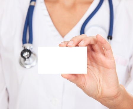 blank area: Female doctor shows empty white card  Stock Photo