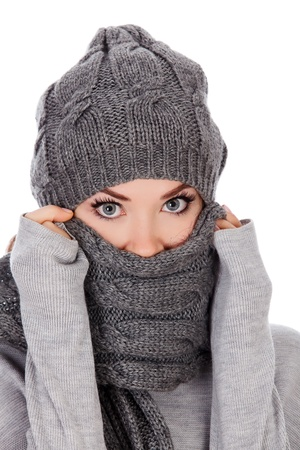 woman with knitted hat and scarf, white background  photo