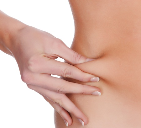 fat belly: woman pinches fat on the belly, isolated on white Stock Photo