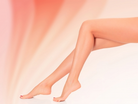 Legs of a woman against abstract background photo