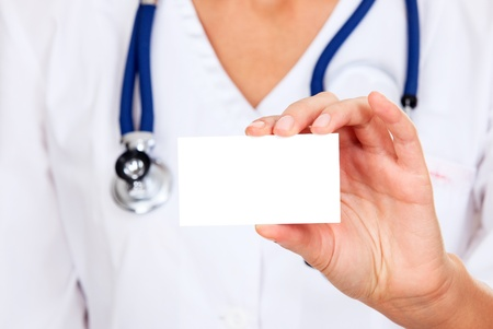 Female doctor shows empty white card Stock Photo - 17689978
