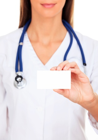 Female doctor shows empty white card  photo