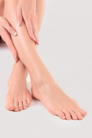 chiropody: Well-groomed hands on female feet