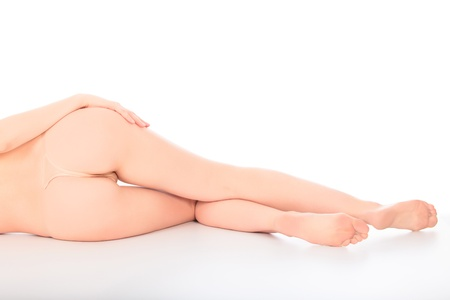 female nudity: Woman laying on a white floor