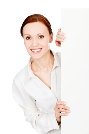Happy smiling young business woman with a blank signboard, isolated on white background  photo