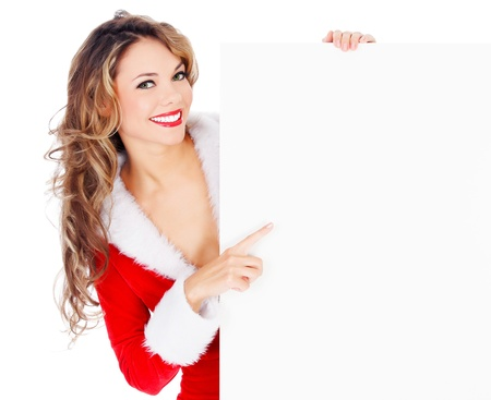 Female Santa pointing at an empty banner, isolated over a white background  photo