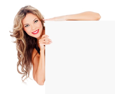 Excited young woman with a blank billboard against white background  photo