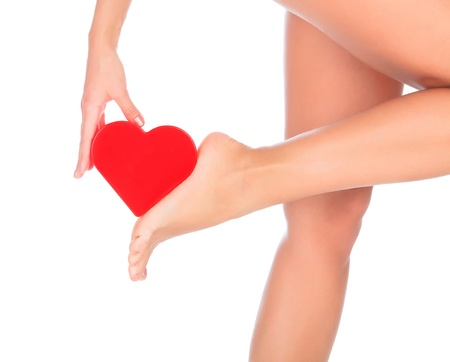 feet naked: I love my feet. Female foot with a red heart Stock Photo