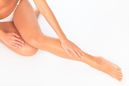 varicose veins: Female legs on white floor Stock Photo
