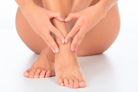 varicose veins: Female feet and hands