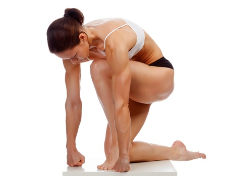 Muscular strong woman on a white background photo