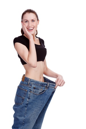 Surprised girl in big jeans Stock Photo - 18790277