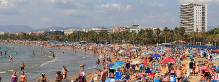 vacationers: SALOU, SPAIN - September 22: Vacationers in Llevant Beach on September 22, 2011 in Salou, Spain. Salou is a major destination for sun and beach for European tourism with more than 50,000 accommodations