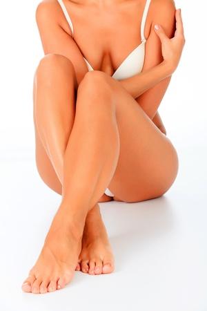 beautiful legs: Woman sitting on the white floor