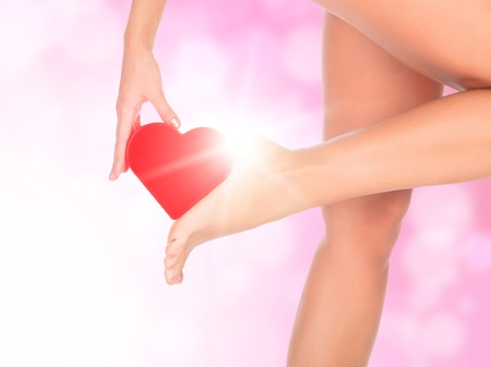 Female legs against a pink background with blurred lights photo