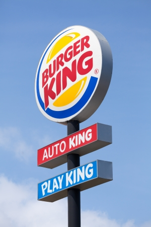 Burger king road sign against bright blue sky