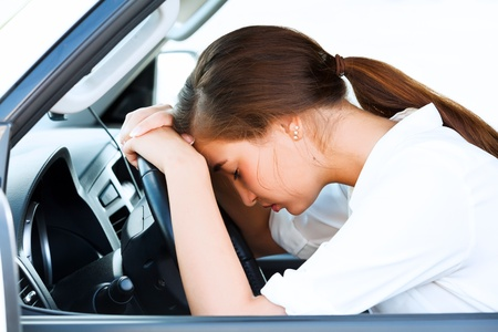 tired person: Girl sleeps in a car