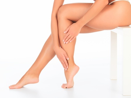 Female legs and hands, white background  photo
