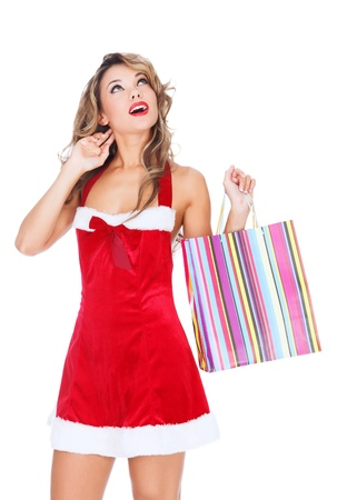 Girl in red dress with a shopping bag, white background, copyspace photo