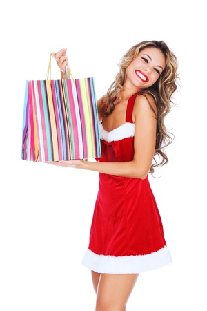 santa suit: Girl in red dress with a shopping bag, white background, copyspace