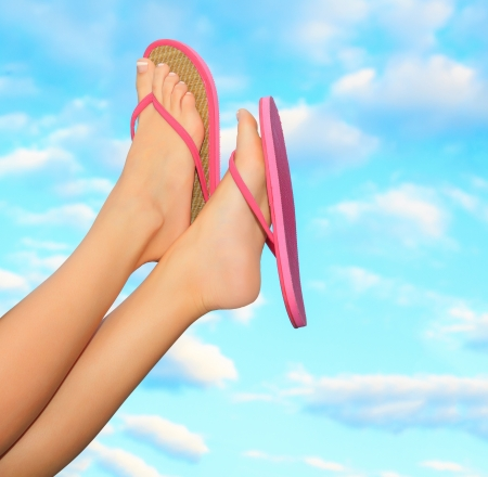 flops: Female legs in pink sandals. Summer concept.