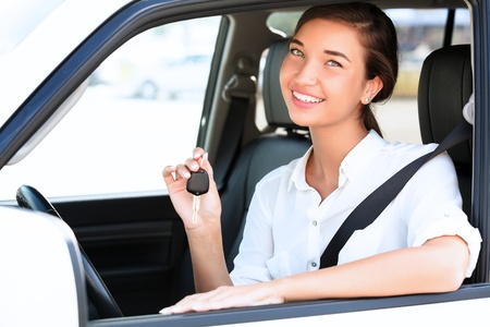 Pretty girl showing the car key Stock Photo - 20864328