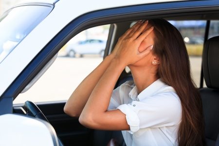 traffic accidents: Crying woman in a car  Stock Photo