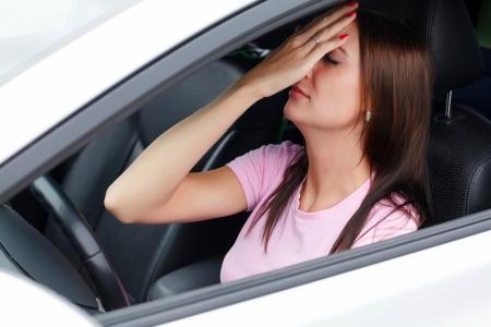 Sad woman in a car  photo